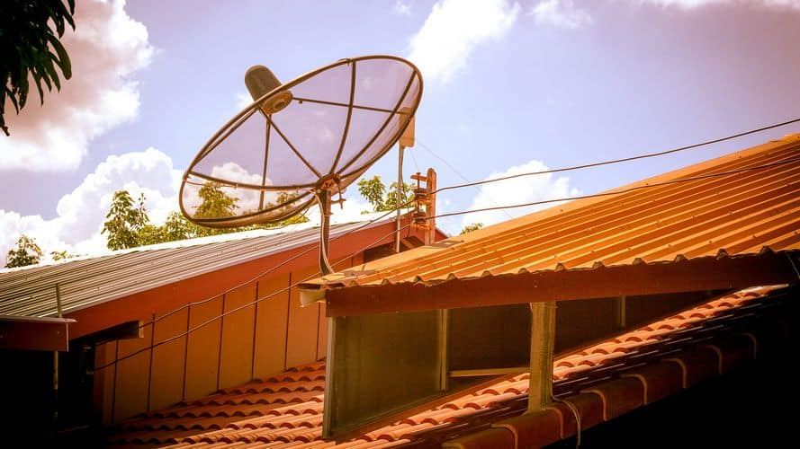 Cabled up antenna on rooftop