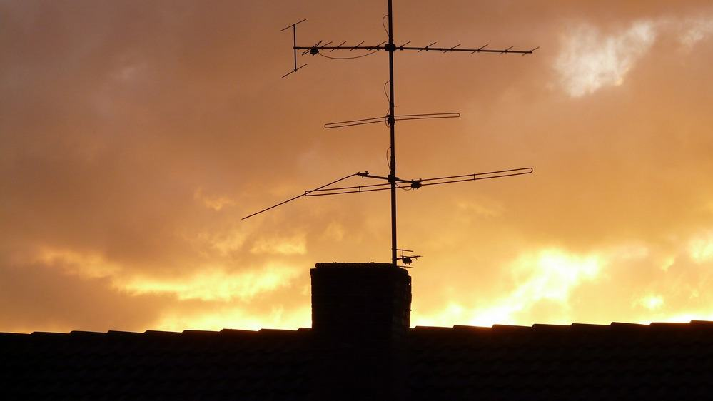 Tv antenna at sunset