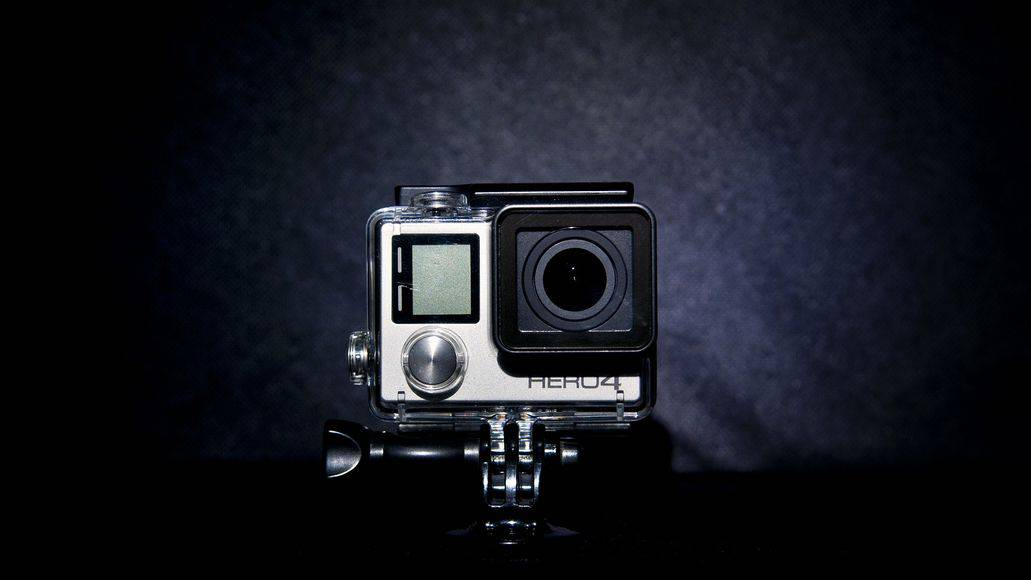 a GoPro camera isolated on dark background