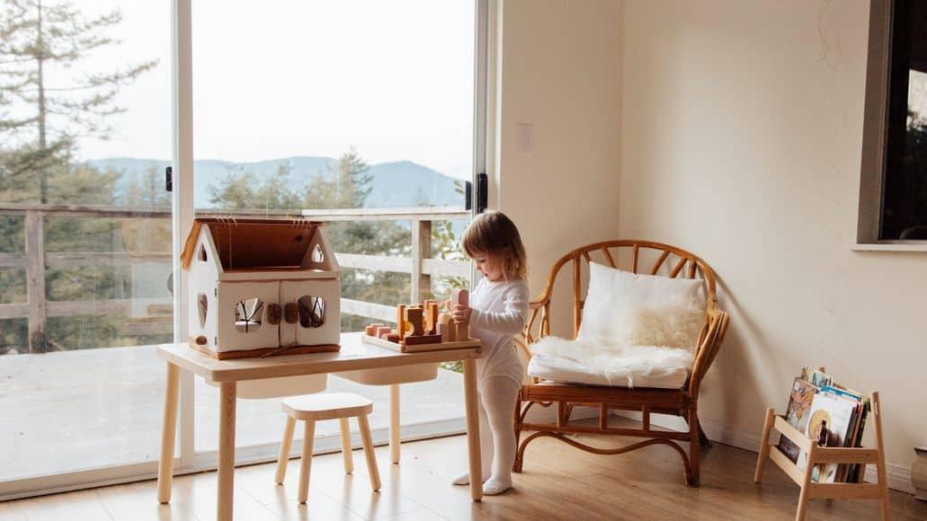 child in front of sliding glass door