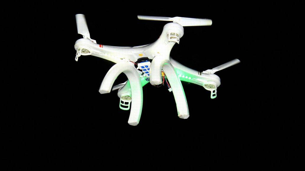 flying drone at nighttime